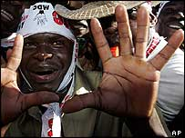 MDC supporter giving their party's open hand salute during a rally