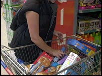 Woman filling trolley in Sainsbury's