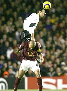 Sparta Prague's Petr Lukas rises above Thierry Henry of Arsenal