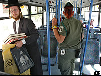 An ultra-orthodox Jew rides in an almost empty bus in Israel