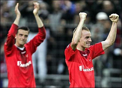 Lille's Milenko Acimovic and Mathieu Chalme