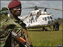 Congolese soldier guarding UN helicopter