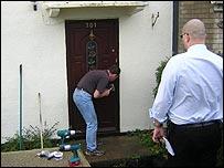 Bailiffs drill a lock
