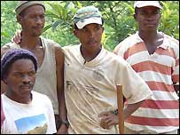 Road builders in Madagascar pose for a photo