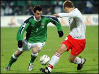 Keith Gillespie (left) tries to get past Poland's Tomasz Rzasa