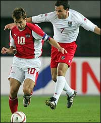 Austria's Andreas Ivanschitz vies for the ball with Carl Fletcher during their Word Cup Qualification match at the Ernst-Happel-Stadion in Vienna