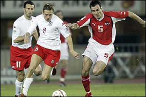 Wales striker Craig Bellamy fights for the ball as the Red Dragons play Austria