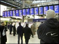 Commuters wait at train station