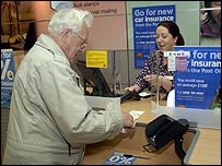 A pensioner at a post office