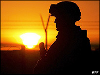 A US troop watches the sun rise in Iraq