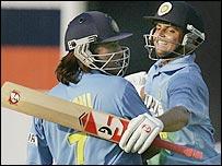 Mahendra Dhoni and Suresh Raina celebrate India's victory in Pune