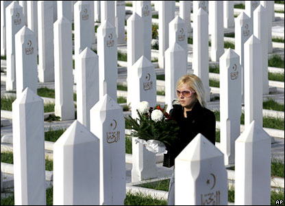 A Bosnian Muslim girl visits a grave at a Sarajevo cemetery