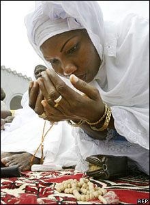 A woman prays for Eid al-Fitr in Abidjan, Ivory Coast