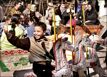 A child enjoys a fairground ride in Cairo, Egypt