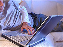 Image of a young person using a laptop