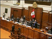 Peruvian legislators applaud after approving the bill