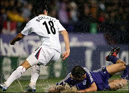 Bolton's Jared Borgetti and Zenit St Petersburg's Egor Denisov battle in the rain