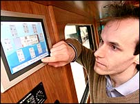 Ben Tristem and a control screen in another camper van built by the same company