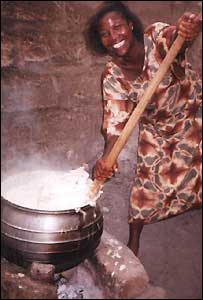 A woman stirring a big pot of food, sent in by BBC News Website reader Ifunanya Ibegbulam