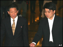 Song Il Ho, left, the vice director of the Asian Department of the North Korean Ministry of Foreign Affairs, walks to a press briefing with a Japanese delegate, 4 Nov