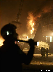 Policeman watches Aulnay-sous-Bois carpet warehouse fire