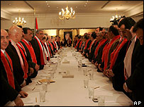 Lebanese opposition leaders observe a minute's silence in respect of Hariri before a meeting at his family home