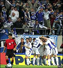 Greek players and fans celebrate