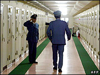 Prison guards checks cells in the Fuchu prison in Tokyo 27 May 2003.
