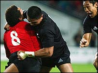Colin Charvis is knocked out by a Jerry Collins tackle