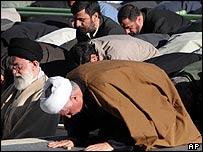Iran's supreme leader Ayatollah Ali Khamenei leading prayers in Tehran, Iran with Iranian President Mahmoud Ahmadinejad