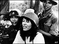 American actress and activist Jane Fonda is surrounded by soldiers and reporters as she sings an anti-war song near Hanoi during the Vietnam War in July 1972
