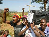 Zanu-PF supporters carrying a mock coffin