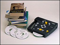 Photo of a DAISY player, books and CDs
