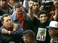 Hugo Chavez (left) with Diego Maradona (arms raised) at Mar del Plata rally
