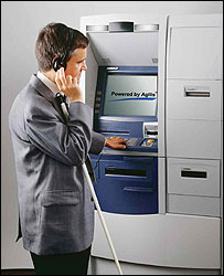 Photo of someone using the Opteva ATM using headphones