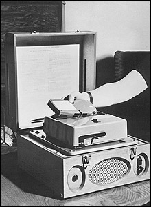 Photo of an early MKI talking book player with an adapter fitted.