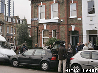 Media gather outside the couple's house in south London
