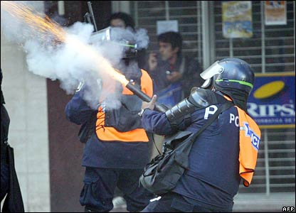 Riot police fire tear gas