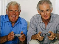 Two older men playing a video game