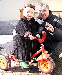 Office driver Alimkhodja Nuritdinov with Monica's son Anvar, aged three
