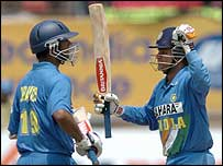 Virender Sehwag celebrates his century with Rahul Dravid