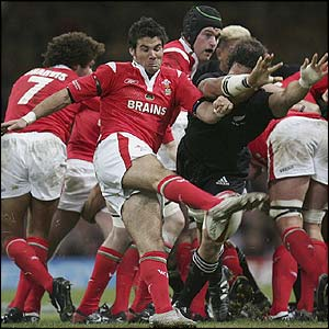 Mike Phillips is forced to kick clear