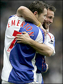 Brett Emerton celebrates his early goal with team-mate Lucas Neill