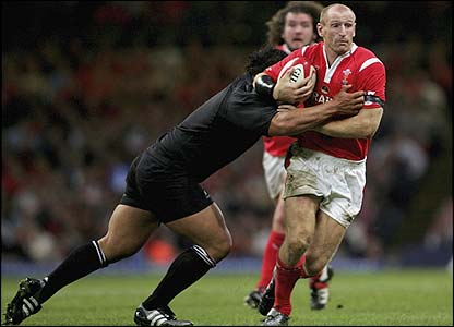 Wales captain Gareth Thomas is tackled by the New Zealand defence