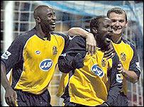 Wigan celebrate Pascal Chimbonda's goal