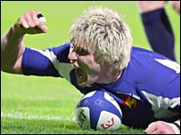 France's Remy Martin celebrates his try