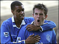 Julian Gray celebrates with Blues goalscorer Darren Carter