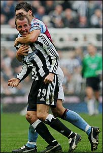 Bowyer is restrained by Gareth Barry
