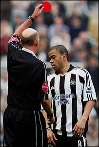 Kieron Dyer is shown the red card