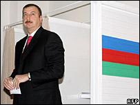 Azerbaijan's President Ilham Aliyev leaves a polling station